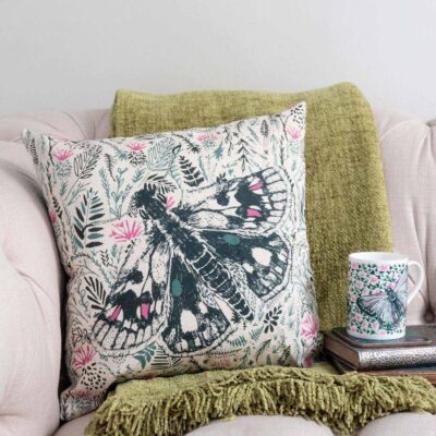 Thistle and butterfly cushion by Cherith Harrison.