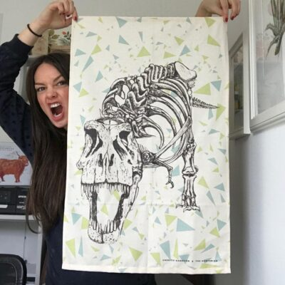Dinosaur Tea Towel featuring a tyrannosaurus skeleton by Cherith Harrison