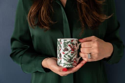 Christmas garden bone china mug by Cherith Harrison